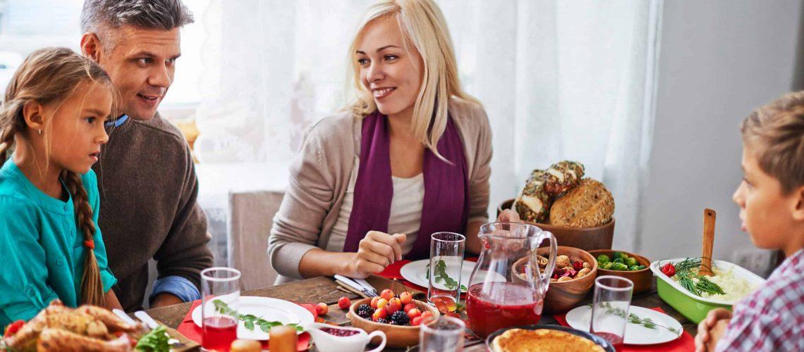 Family of four having dinner at thanksgiving day