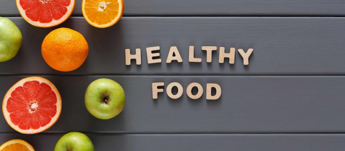 Healthy food and slimming background copy space. Fruits and text healthy food top view. Diet, weightloss concept
