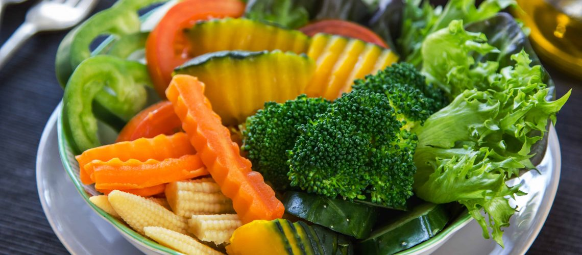 Pumpkin,Broccoli with carrot and baby corn salad in a bowlg